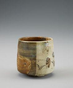 Shiga ware cylindrical tea bowl in Oribe style 18th-19th century   Edo period  Stoneware with iron glaze and black enamel over clear glaze H: 8.7 W: 9.1 D: 9.1 cm Tsushima island, Japan