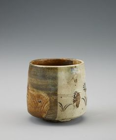 Shiga ware cylindrical tea bowl in Oribe style 18th-19th century Edo period Stoneware with iron glaze and black enamel over clear glaze H: 8.7 W: 9.1 D: 9.1 cm Tsushima island, Japan