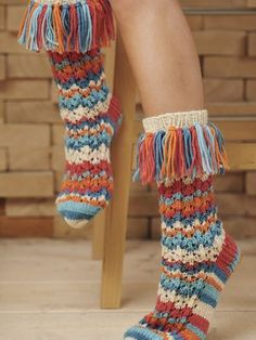 These socks are wild - in a good way! The vibrant colouring, the lace pattern and the tassels make these socks a fun project to knit and to wear. Knitted with Novita 7 Veljestä wool yarn Knitting ProjectsCrochet For BeginnersCrochet PatternsCrochet Bag Crochet Socks, Knitting Socks, Knit Crochet, Free Knitting, Lace Patterns, Knitting Patterns, Cool Outfits, Summer Outfits, Easy Knitting Projects