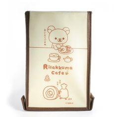 """Rilakkuma Cafe 10"""" 1/4 x 6"""" 1/2 x 5"""" collapsible storage box by Rilakkuma. $12.99. Rilakkuma collapsible storage box.. Organize your shelves with this Rilakkuma Cafe 6.5"""" x 17"""" x 5"""" collapsible Storage Box. The bin features a design of Rilakkuma, along with a brown strap handle on the front. It comes packaged in a clear plastic bag, with a Japanese text insert."""