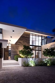 "Franco Residence by KZ Architecture  The architects of KZ Architecture present another result of their creative work. This impressive home at the coast of Florida is named ""Franco Residence"" and stands for warmth and elegance. The six-member family required a lot of space and freedom for their new home. This is mainly ensured by the use of many glass surfaces and the large living, dining and family rooms as well as the large kitchen."