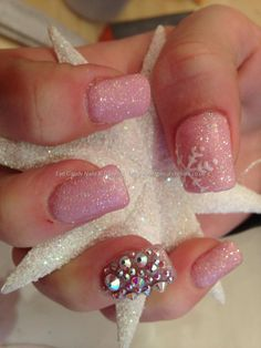 Acrylic nails with pink glitter polish and glitter dust with Swarovski crystals on ring finger