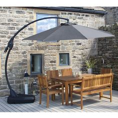 As garden parasols go, I like the ability of this one to hang over a table or seating area, rather than be stuck in the middle of it.