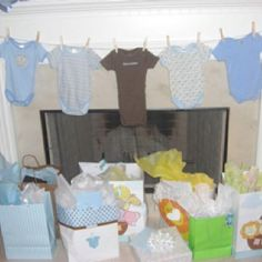 Baby boy shower decor - great idea! I have lots of baby boy onesies!!! :D