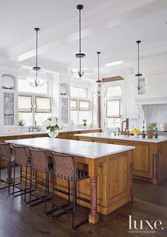 Long outfitted the bistro-style kitchen with globe pendants by Hector finch Lighting and mark albrecht leather-woven barstools.