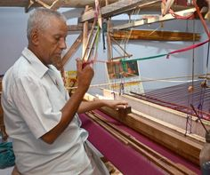 Weaver B. Thiagarajan weaving a handloom sari at his home in Tiruchi, India