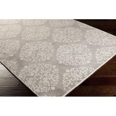 This grey and white patterned area rug is classy and stylish. The neutral tones can easily match with multiple decor styles.