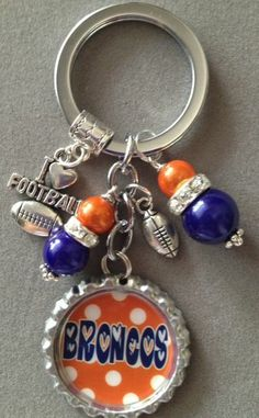This listing is for one Denver Broncos inspired bottle cap key chain. This is a must for any Denver Broncos fan! It is decorated with blue and orange beads, an I love football charm and a mini football charm. If this isn't your favorite team, just send me an e-mail and I can make the perfe...