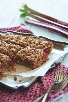 Wholegrain rhubarb crumble bars, with almond meal, oats, & coconut. A treat whether for breakfast or dessert, and vegan! http:toughcookieblog.com