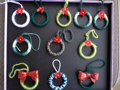 All of the mini wreath ornaments I've made so far. Yarn and bows came from A.C. Moore. The yarn is wrapped around old shower curtain rings.