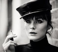 DOWNTON ABBEY's LADY MARY!!!  She's smoking! In another shot the actress is seen with a rolled-up cigarette in her hand and a leather cap perched on her head.