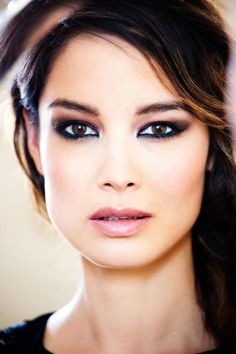 A close up shot of Berenice Marlohe taken by photographer Paolo Pelligrin in Venice, 2012. The facial expressions shown in this photo are seductive are this is anchored by her make up and her gaze into the camera.