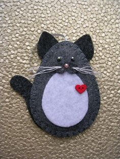 This charming gray and white kitty cat measures approx. 4 high x 3 1/2 wide. It is hand cut and sewn and lightly padded with fiberfill. The cats listed are my own design and are an artistic abstract interpretation of certain breeds. PLEASE CHOOSE AN EYE COLOR--light green, amber, light blue,
