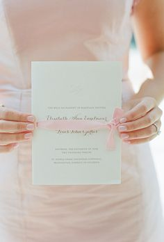 Classic, white wedding ceremony program with pink ribbon by Simplesong Fine Letterpress Goods (Photo: Kate Headley)