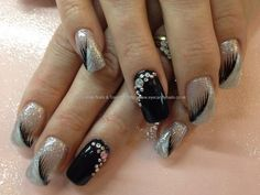 Nail Art Photo Taken at:30/05/2013 11:11:00 Nail Art Photo Uploaded at:30/05/2013 21:20:43 Nail Technician:Elaine Moore Description: Black and white feather freehand nail art with Swarovski crystals over acrylic nails  @ www.eyecandynails.co.uk