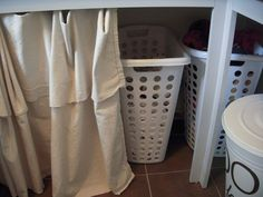 And to hide everything - a simple painter's drop cloth curtain for about $20!