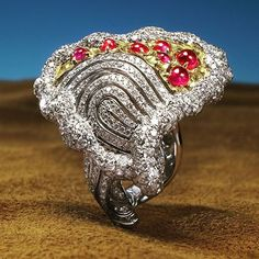 annahu_hautejoaillerieHappy Chinese Valentine's Day! Anna created her Heart Print ring to represent her love for jewelry. It features 7 cabochon Burmese rubies and round brilliant cut diamonds set in a symbolic heart stamped with her own thumbprint.