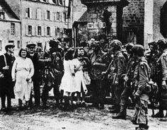 Paratroopers of the 101st Airborne Division in the town square of Sainte Marie-du-Mont shortly after the assault on D Day, June 6, 1944
