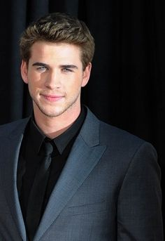 "Liam Hemsworth. Why do women like him? Is it because he's 6'3"" tall? Is it because he has broad shoulders? Beautiful face? What is it?"