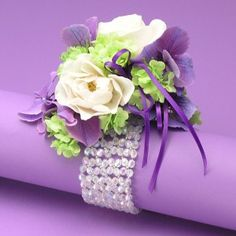 wrist corsage bracelet - complete with clear plastic platform to attach flowers to - no wiring required £2.50 !