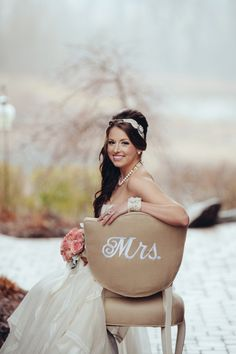 """Photography by:  Crystal Stokes Photography. Love the chair """"Mrs."""" idea."""