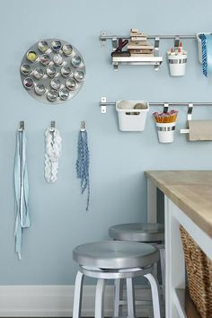 One thing about creative projects: They tend to spread, so store your tools and supplies within easy reach yet off your work surface. Wall systems typically geared to kitchen storage (including a magnetic wall-mounted spice rack) are ideally suited to craft-room needs