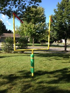 Semi-permanent field telescopic goal post from pvc pipe, giant pool noodle, crepe paper, duct tape, metal post