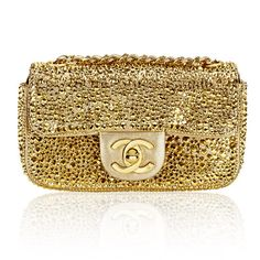 ...Gold studded beauty by Chanel