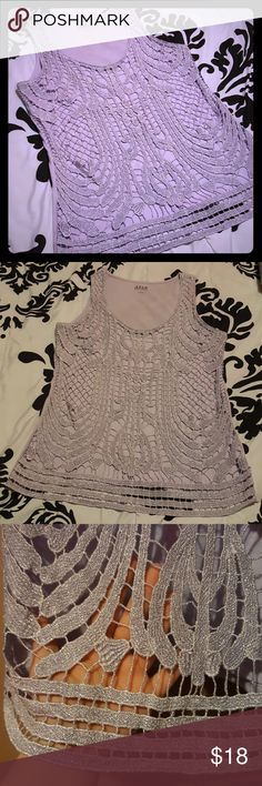 Purple tank top This is an a.n.a tank top! Very pretty! Light Purple in color with a silver shimmer! Brand new - no tags - NEVER been worn! Size Large!  Coming from a pet friendly household! No lowballing - please be courteous to Poshmark fees! a.n.a Tops Tank Tops