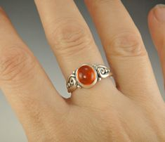 R892- Sterling Silver Ring with a 7 x 8 mm Orange Mexican Fire Opal Cabochon, , Size 8 1/4. **The stone in this ring is not set yet** so it is easier for me to size without damaging the stone. That is why the bezel looks funny. I can size it to fit, just contact me. No charge to