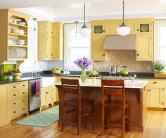 Look for base cabinetry shaped with legs that make it look like a piece of freestanding furniture. Incorporate functional space for dishes that also puts them on display, such as open shelves and plate racks. Add exposed hinges and knobs and pulls that look old-fashioned. The vintage shape of the light fixtures in this kitchen also contributes country flair.