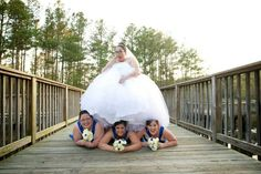 Bridesmaids under my wedding dress at the Virginia aquarium