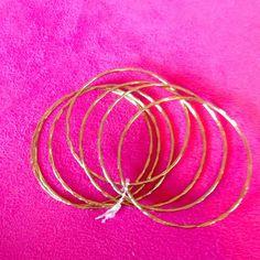 Gold seven piece bracelet It is a seven piece bracelet that has gold diamonds and lines on it Jewelry Bracelets
