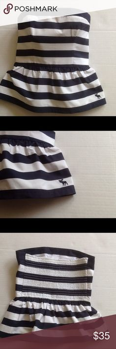 Peplum strapless top by Abercrombie & Fitch Navy and white strips..so cute for summer with a pair of white shorts. Size is medium. Length is 15 1/2. There is a stretch band across the back whip is 11 inches. As shown. Abercrombie & Fitch Tops