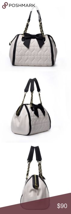 """🚨⤵️ONLY TODAY🚨😍👛Betsey Johnson Bag😍👛 Top zipper closure, Chain detail handles 7"""" drop Allover heart quilted exterior with black trim detail. Bow embellishment, back signature logo and flat bottom for upright stucture Fully lined XOX Betsey interior lining with 2 slip pockets and wall zip pocket Handbag measures: 12"""" x 10"""" x 8"""" (WxHxD) Betsey Johnson Bags Shoulder Bags"""