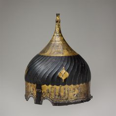 Turban Helmet.  Date:     late 15th century. Culture:     Iranian. Medium:     Steel, engraved and damascened with gold and silver.
