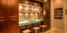 For the Finest in Custom Woodworking! Guildcraft serves the Atlanta area, creating high-end, custom millwork like custom old world wine cellars with tasting r. Built In Media Center, Built In Bar, Built Ins, Puck Lights, Wet Bars, Bar Areas, Tasting Room, Custom Woodworking, New Homes