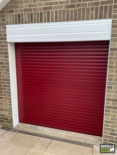 Electric garage doors in red guarantee to make your garage stand out. If you're searching for 'roller doors near me', you'll be pleased to know that we install electric garage doors UK wide. Click the link to find out more! Garage Doors Uk, Red Garage Door, Single Garage Door, Electric Garage Doors, Garage Door Makeover, Garage Walls, Roller Doors, Roller Shutters, Electric Rollers