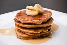 Banana Protein Pancakes:   1/2 cup oatmeal, 1/2 low fat cottage cheese,  1 tsp vanilla,  4 egg whites, 1/2 medium banana. Blend all ingredients together. Heat skillet to medium heat. Cook each pancake for 1-2 min on each side until golden brown. Top with the left over banana, peanut butter, and sugar free maple syrup. Makes for a great breakfast! Around 280 calories and 20g of protein.