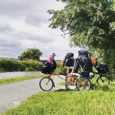 Bicycle touring with loaded panniers.