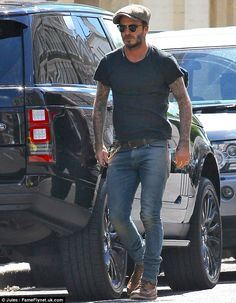 Hunk: David Beckham looked every inch a hunk when he stepped out in London on Wednesday in casual clothes