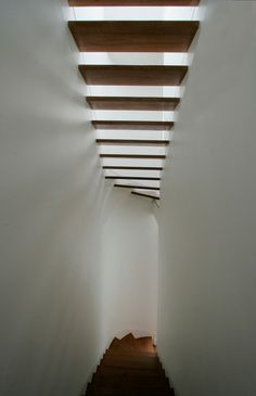 Stairs that are a work or art, love the way the light passes through the stairs and create another design!