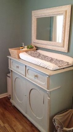 Antique server used as baby changing table. Love the organization with the basket next to the pad.