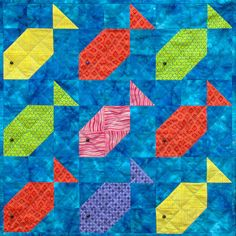 Fishy Nine-Patch is simple enough for someone with only basic quilting skills to construct very easily. This two-value design is well suited to scrap quilts, but it's especially effective using one watery background fabric and a single, unique fabric for each fish, as demonstrated in the sample quilt shown here. Geometric prints and irregular stripes work very well with this approach. From Prairie Queen Pattern Company.