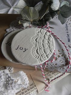 ornament. pic out key bible words for the season...love, joy , peace, hope, faith....and print them on these and give away to friends as a set!