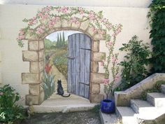 Secret garden mural : The painting of a mural of a door leading to a secret garden. Check out how it was designed and a time lapse video of its creation. Secret garden mural : Bilingual article about a mural painting of a door leading to a secret garden. Garden Mural, Garden Painting, Outdoor Wall Art, Outdoor Walls, Mural Wall Art, Mural Painting, Art Mural En Plein Air, Painted Shed, Painted Fences