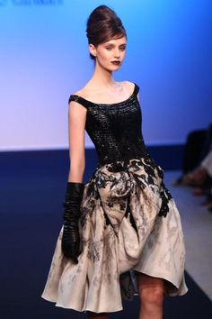 Georges Chakra  couture-French style.  Karen - the couture I like, the sullen pale sunken cheeked emaciated women modelling the clothes look like internment camp survivors! not cool
