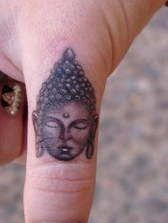 Buddha Portrait on Finger. Inked by Mario Sanchez. That much detail on such a small tattoo...Mario, you're good!