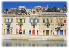 Brightly coloured windows and #doors valletta #malta waterfront. What a gorgeous pic.