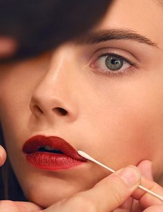 Cara Delevingne wearing Burberry Siren Red lips